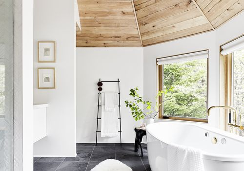 bathroom with wooden ceiling and white walls