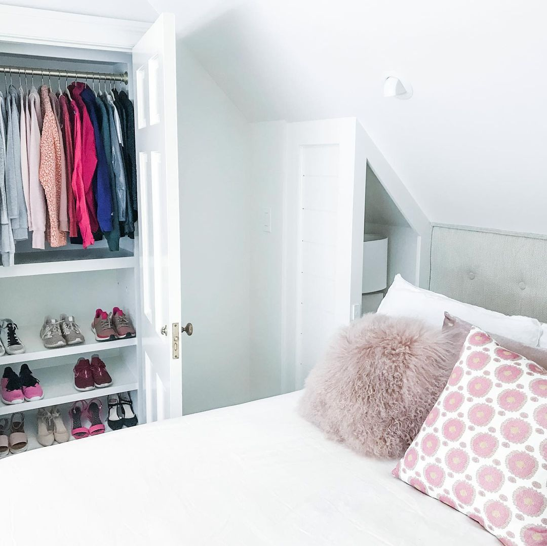 Bright white bedroom with organized closet.