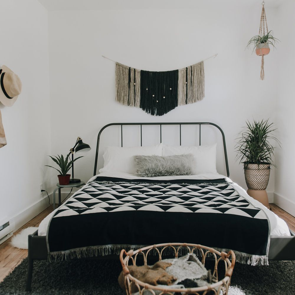 Bohemian black and white bedroom.