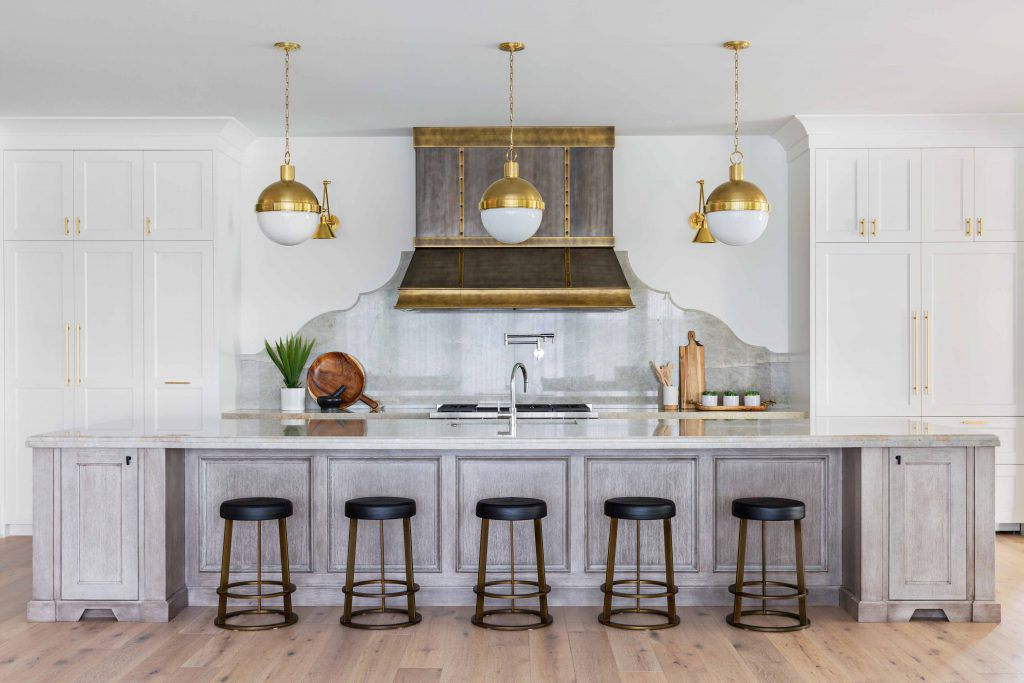 A large open-concept kitchen with rustic features