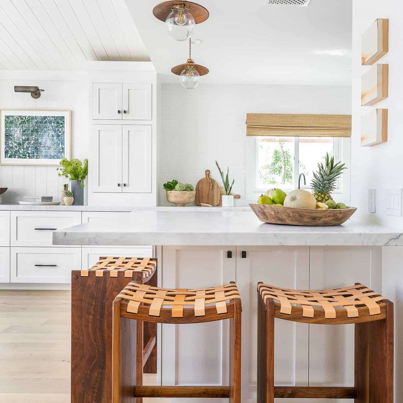 An open-concept kitchen with a wraparound bar