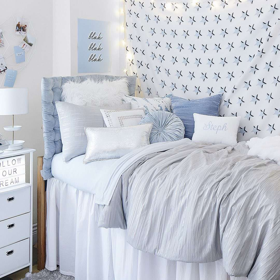Ice blue dorm room bed.