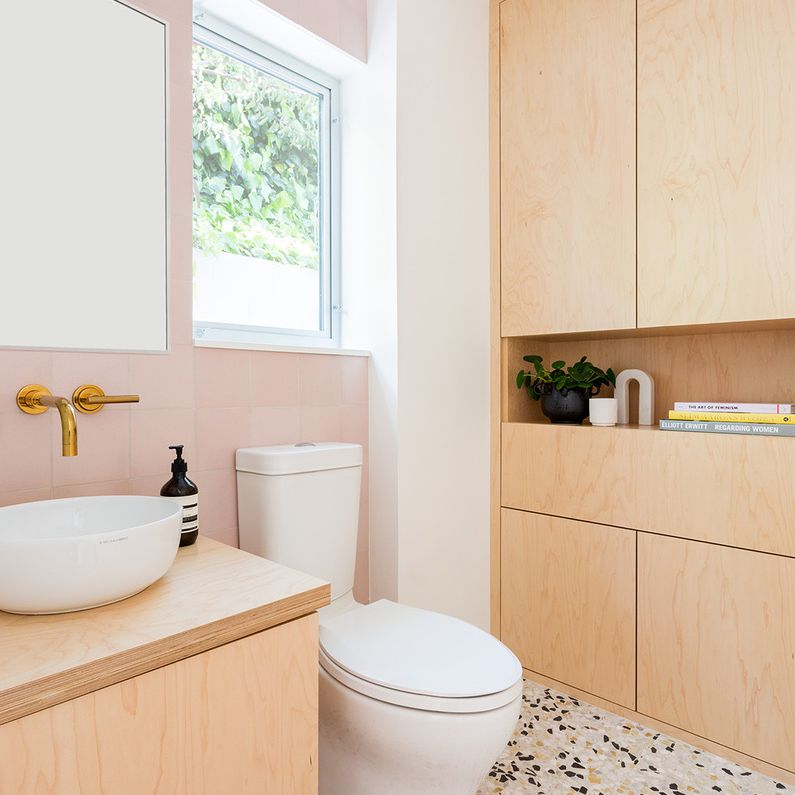 Plywood clad bathroom with blush and gold accents