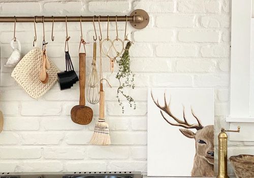 best kitchen organizing ideas - hang pots and cooking tools above the stove