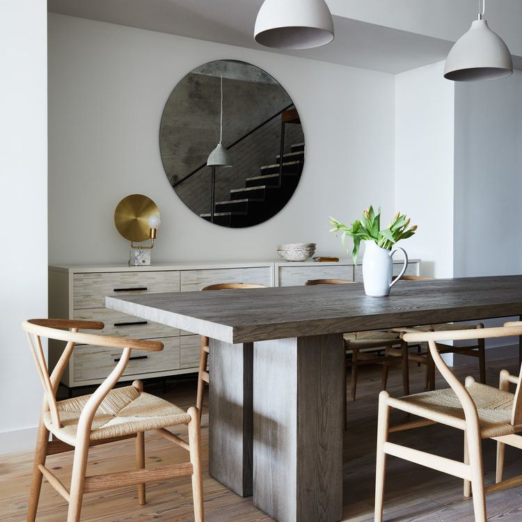 Minimalist Scandinavian-inspired dining room with natural wood elements