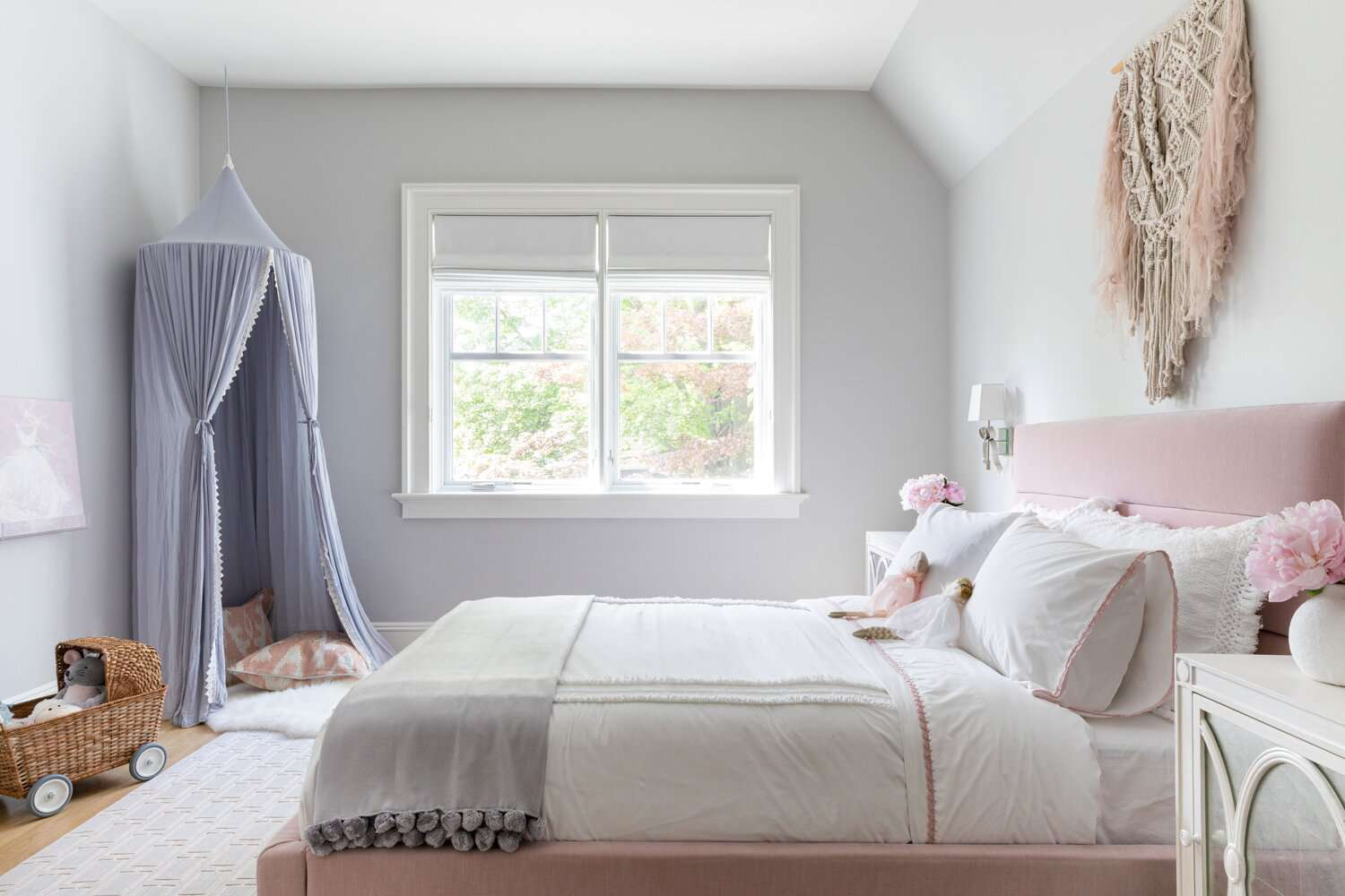 Little girl's bedroom with light gray walls and pink and lilac accents