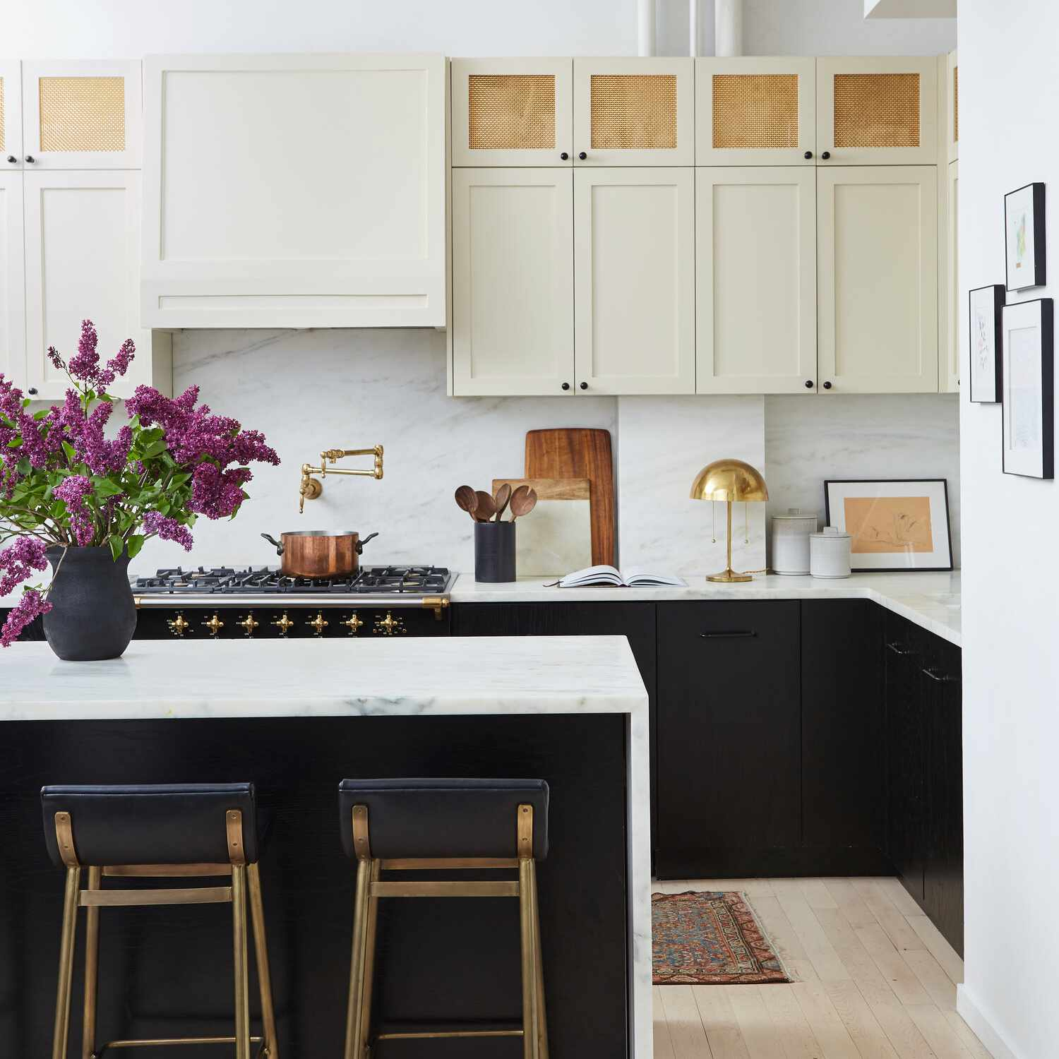 A kitchen with three different kinds of cabinets