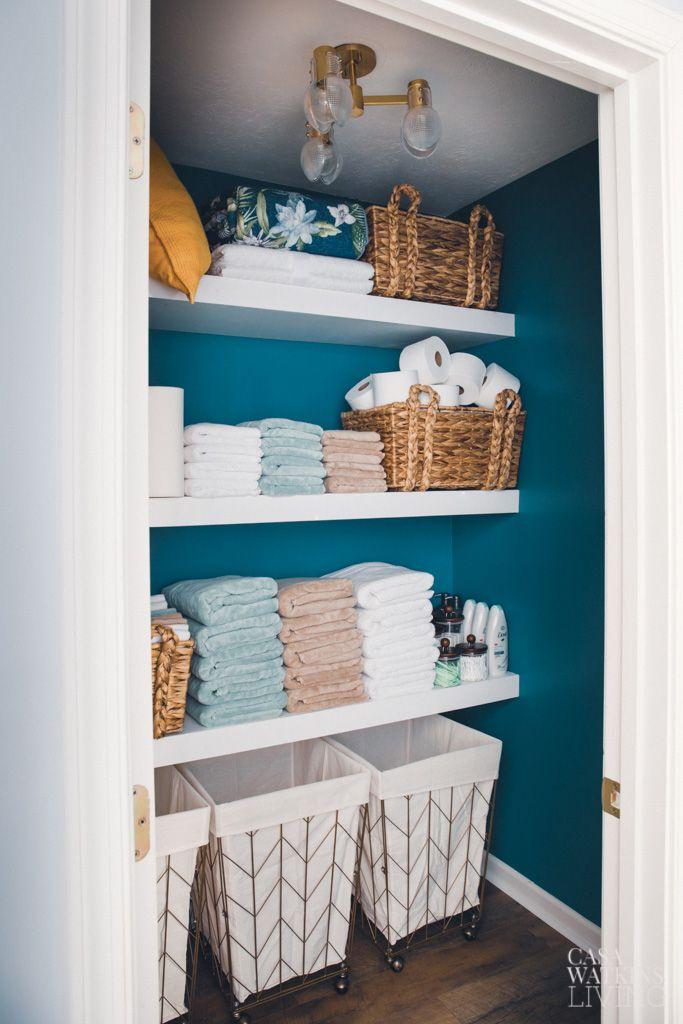 Linen closet painted Behr Caribe