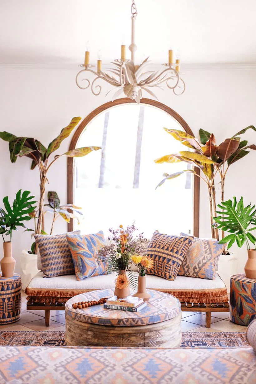 Bohemian living room with multi-patterned throw pillows, and area rug