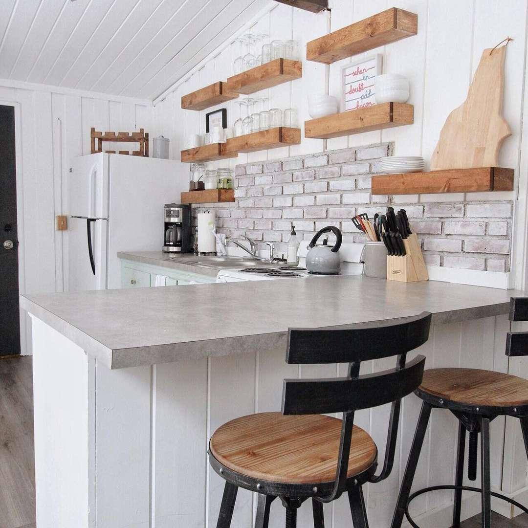 White kitchen with stone backsplash