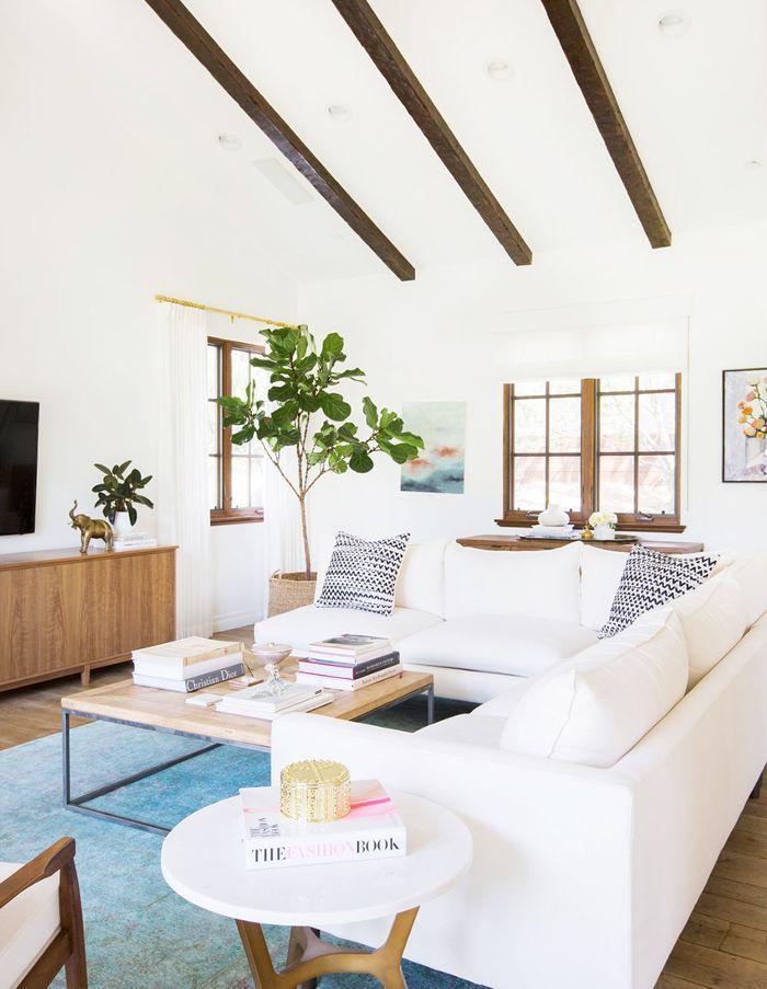 L-shaped white sofa around coffee table