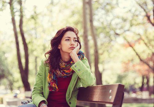 sad woman on bench