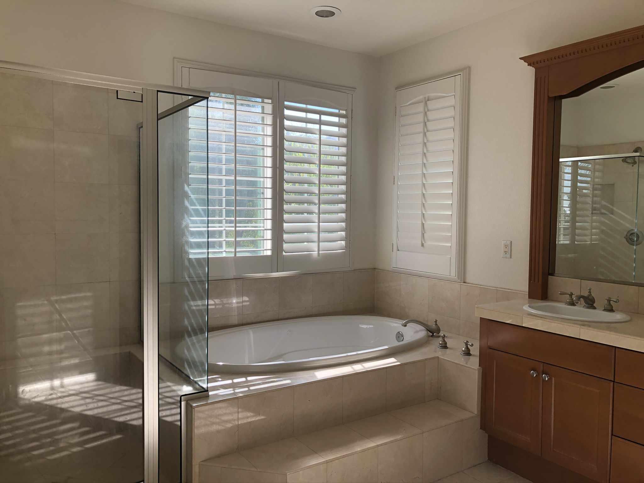 Old bathroom with brown vanity.