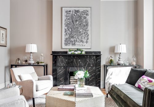 Luxe living room space with marble fireplace.