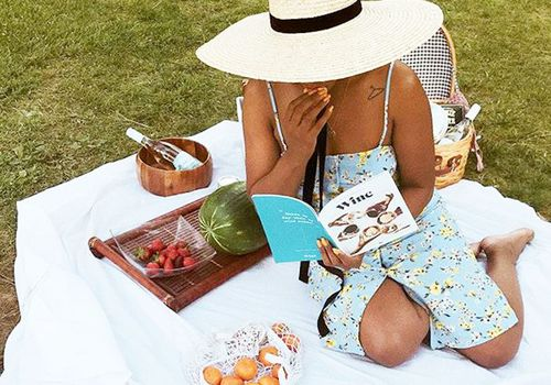 woman with book and picnic