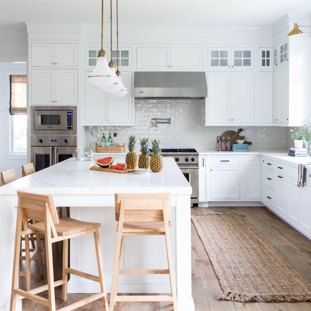Minimalist kitchen with jute runner, wooden barstools