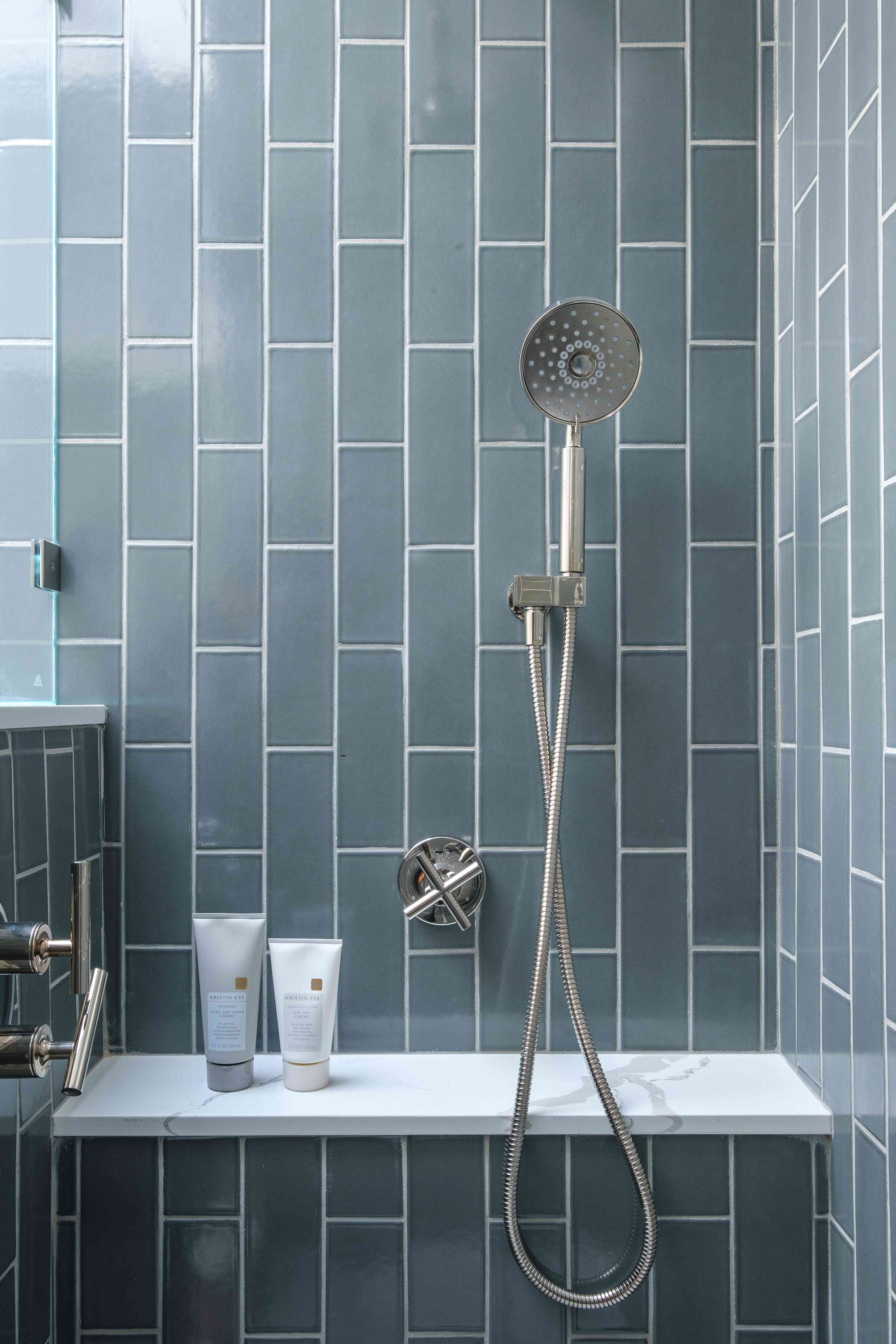 makeover of the week - gina rachelle- small bathroom- vertical subway tile