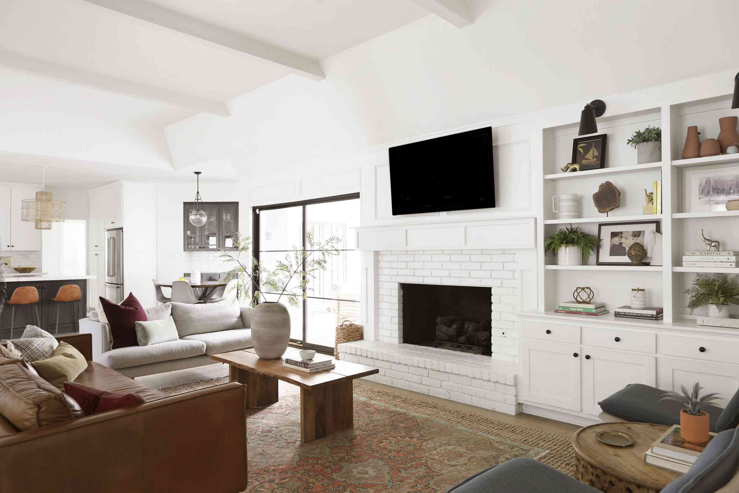 Living room with TV over the fireplace