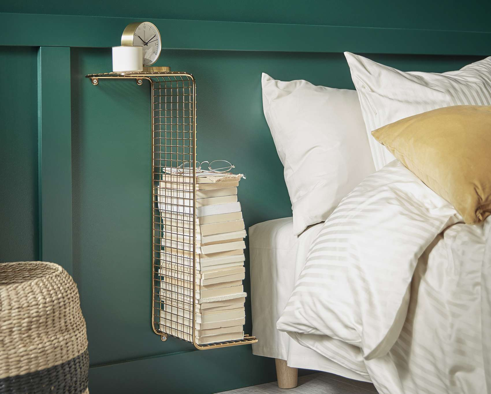 green bedroom with a gold hanging shelf