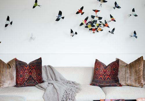 Living room with 3D bird art.