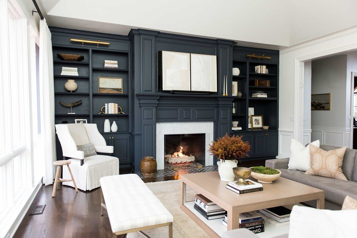 Living room with blue accent wall and built-ins.