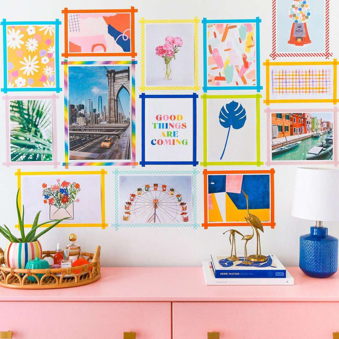 Colorful Washi tape gallery wall hung over light pink dresser