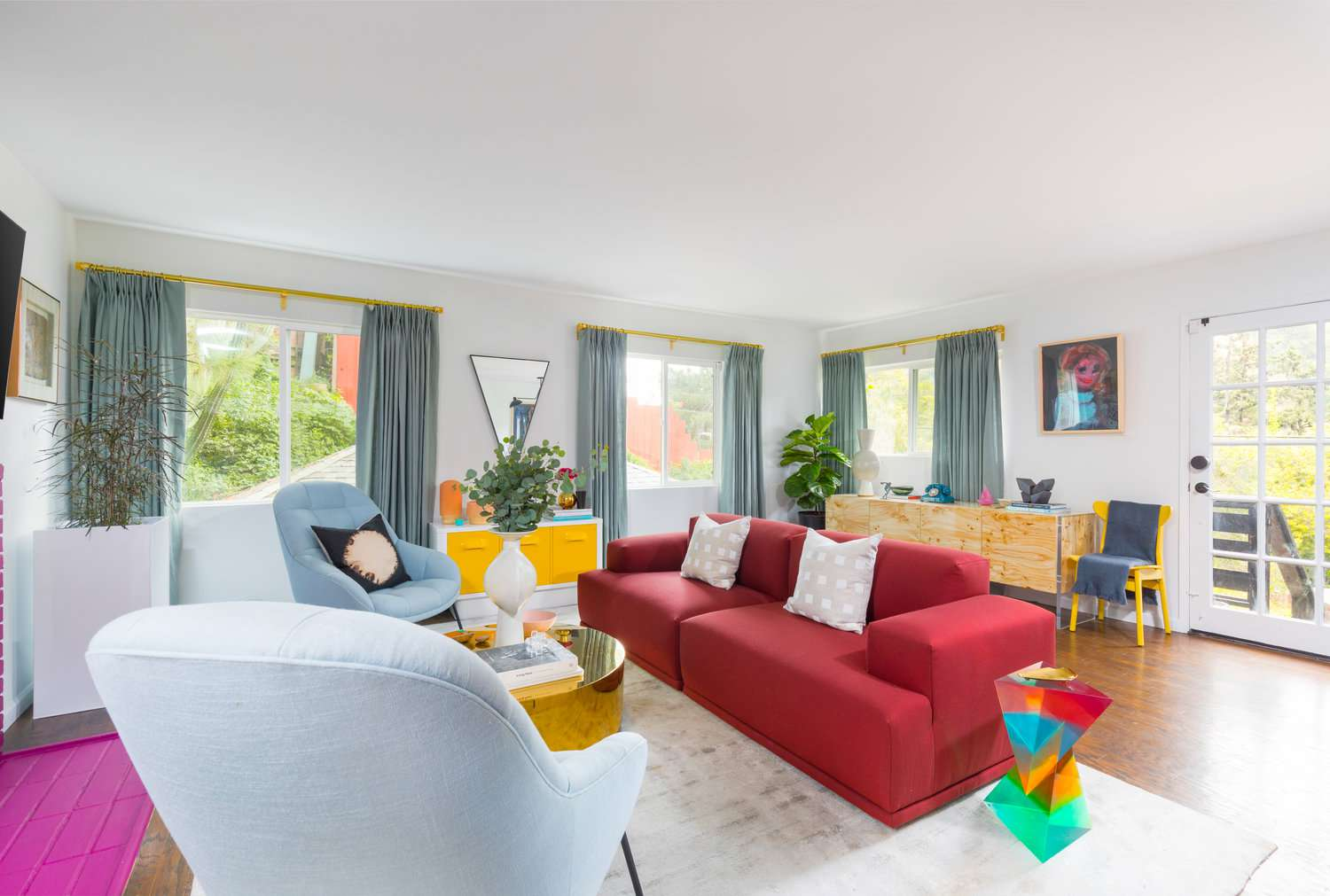 maximalist living room with red sofa