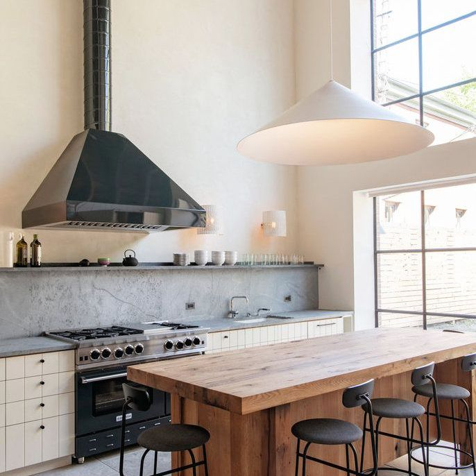 Kitchen with large vent hood