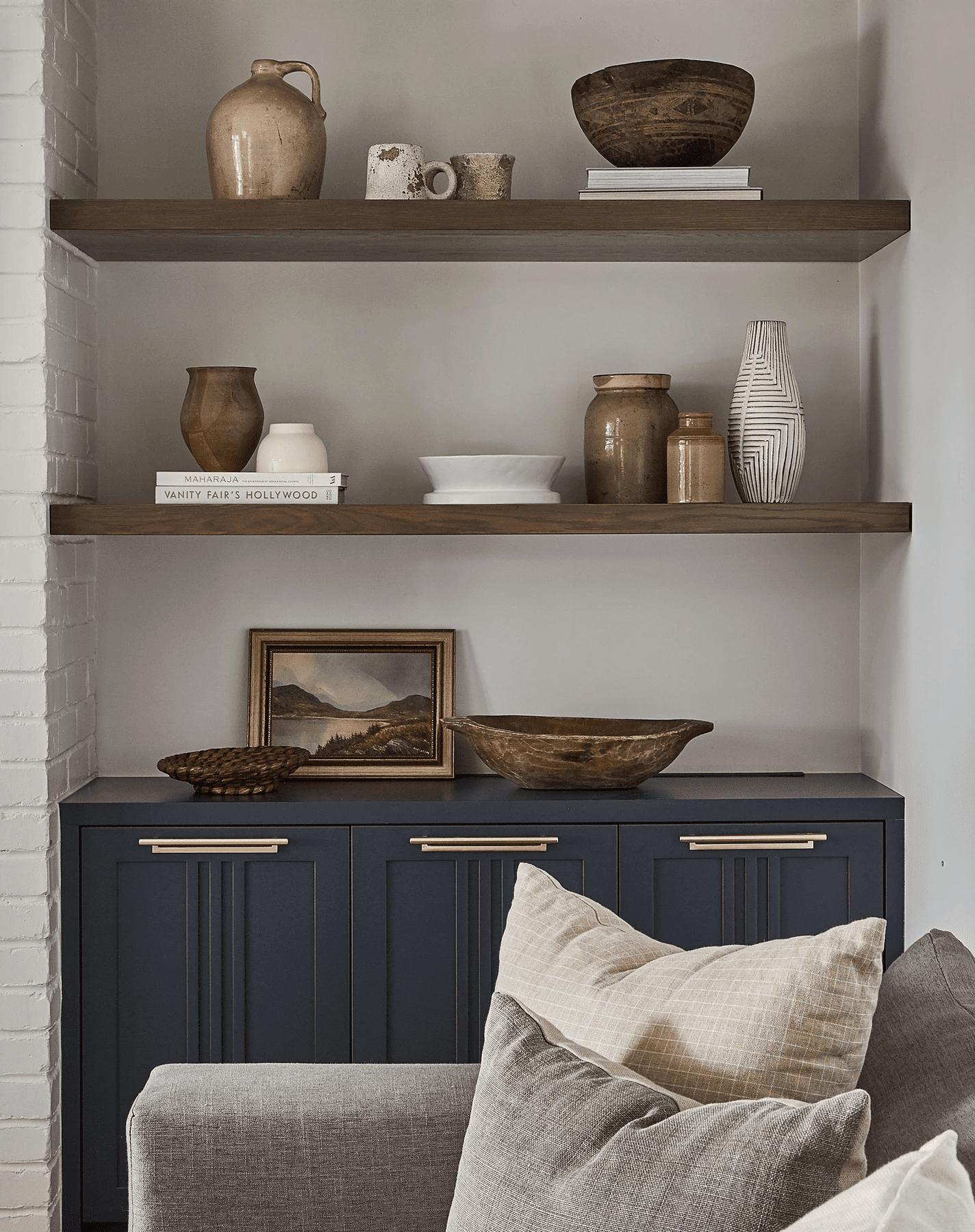 Bookshelves with vintage decor pieces.