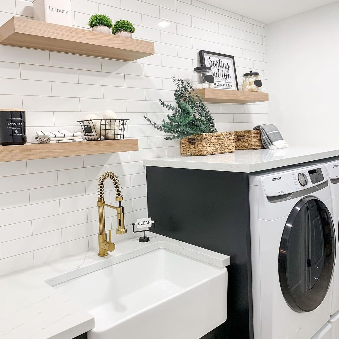 Laundry room with natural wood shelves