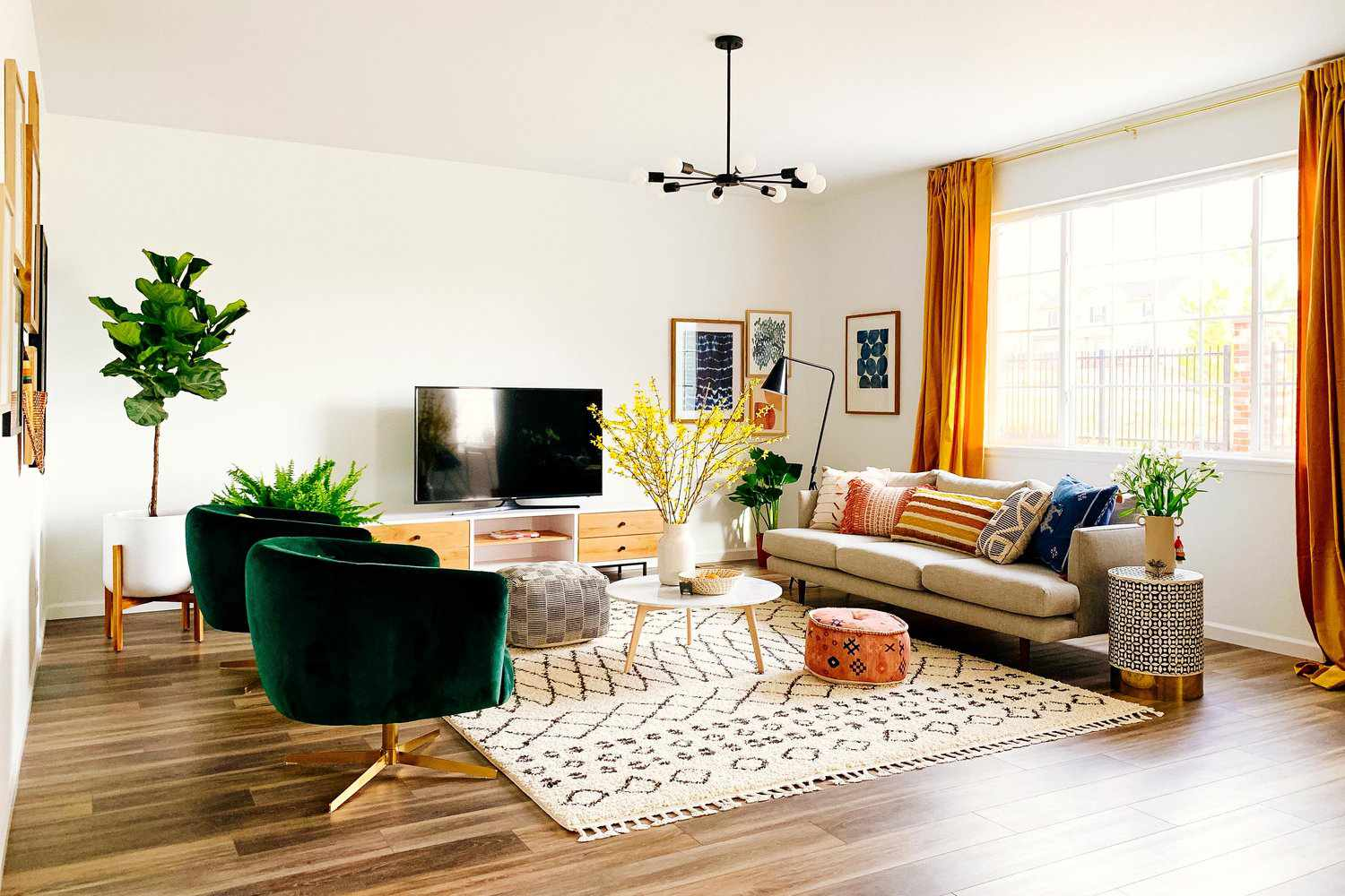 living room with orange curtains emerald chairs