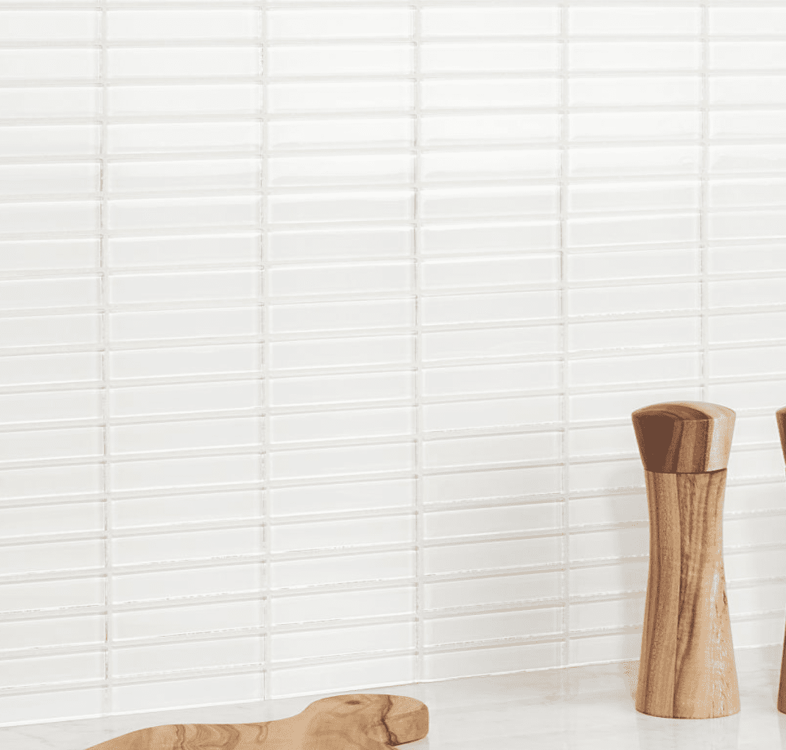 A wall lined with super-skinny white tiles