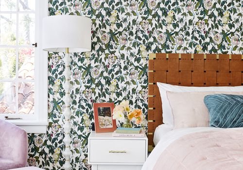 bedroom with floral wallpaper and pink bedding