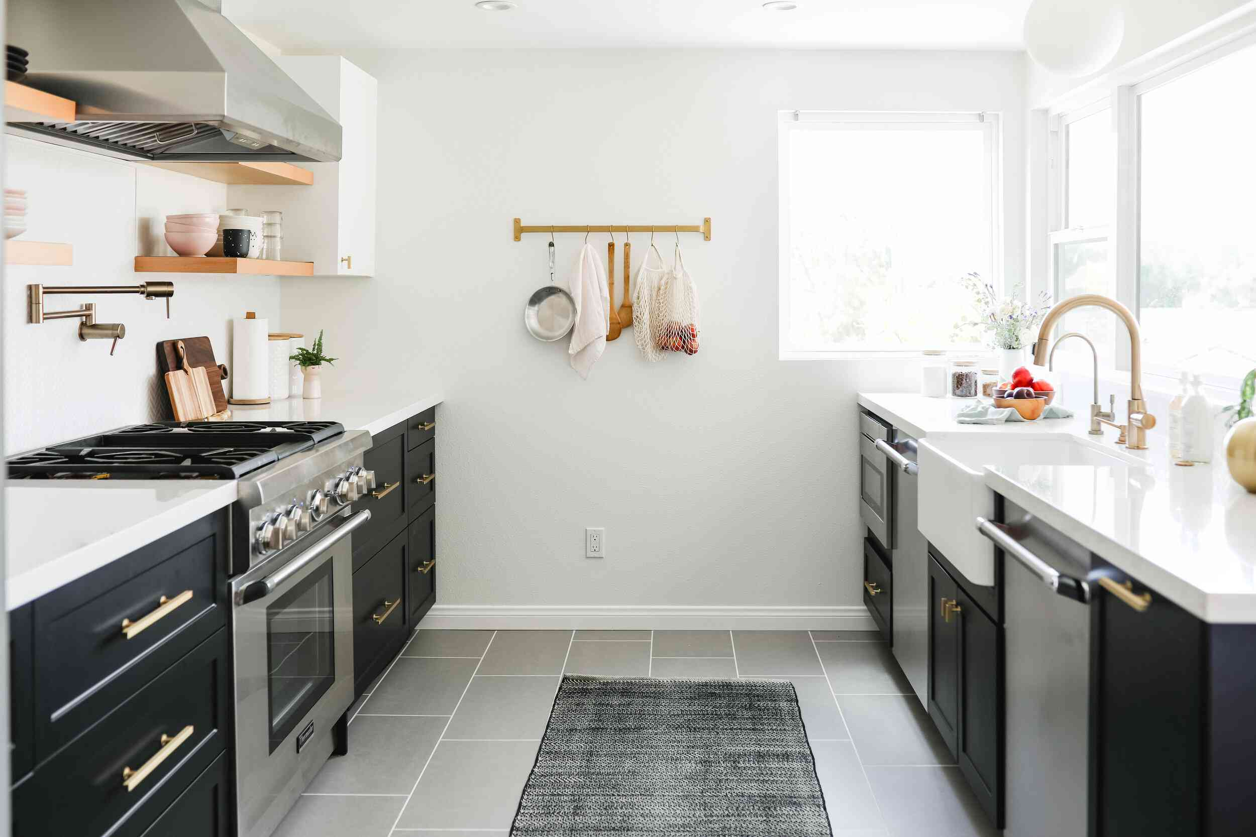A cabinet-lined kitchen with an almost bare wall