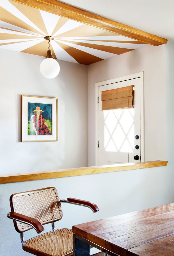 entryway with starburst painted ceiling, rustic orange and white