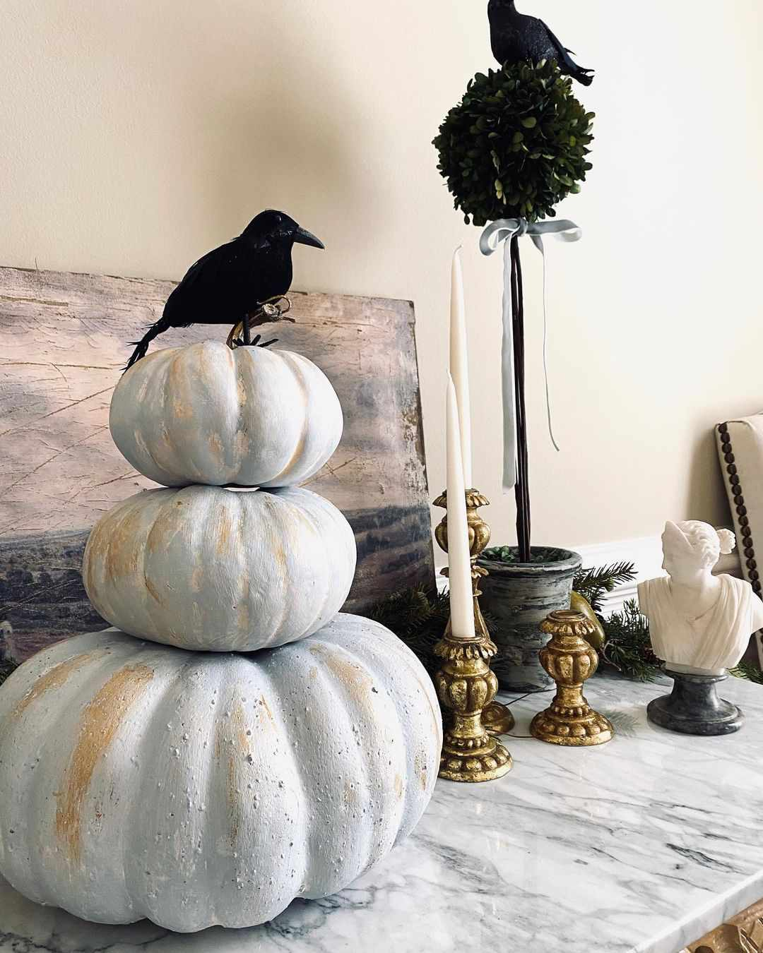 Pumpkins with crow on top