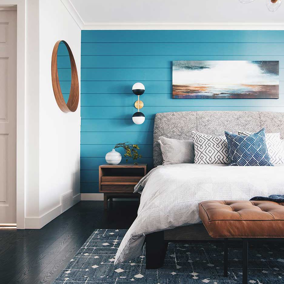 Blue bedroom with shiplap wall