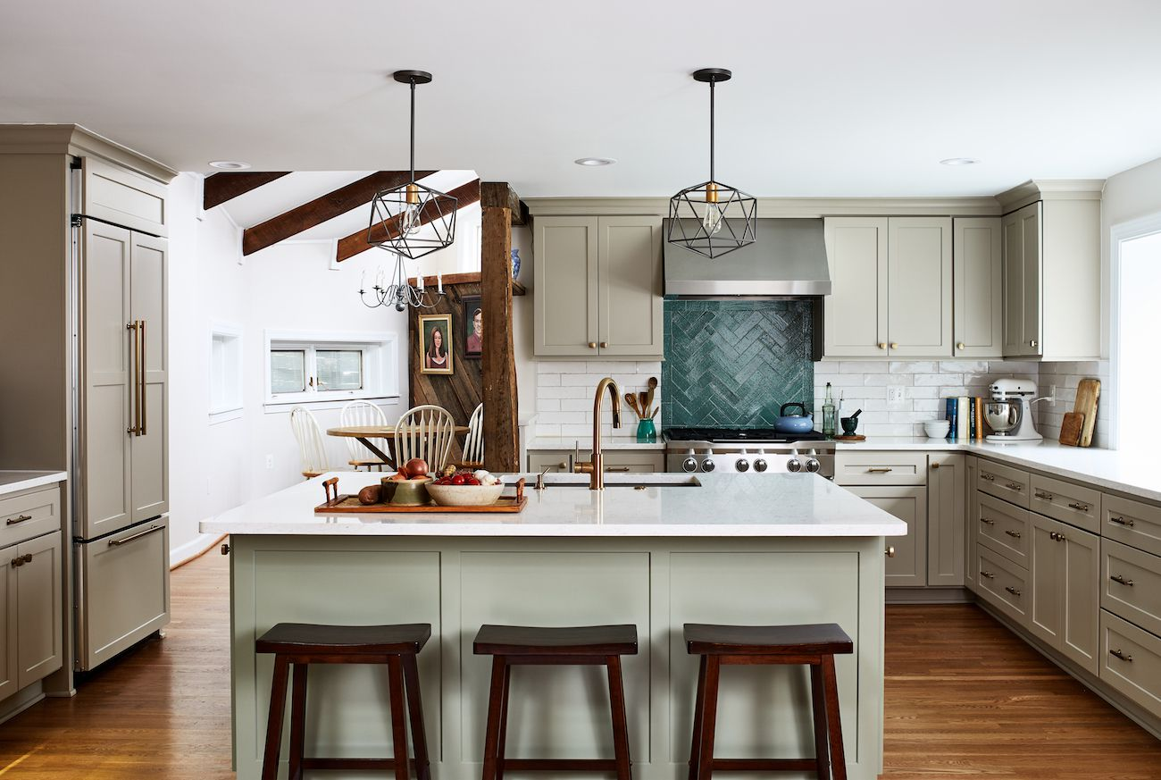 Kitchen with rustic wooden beams and green cabinets