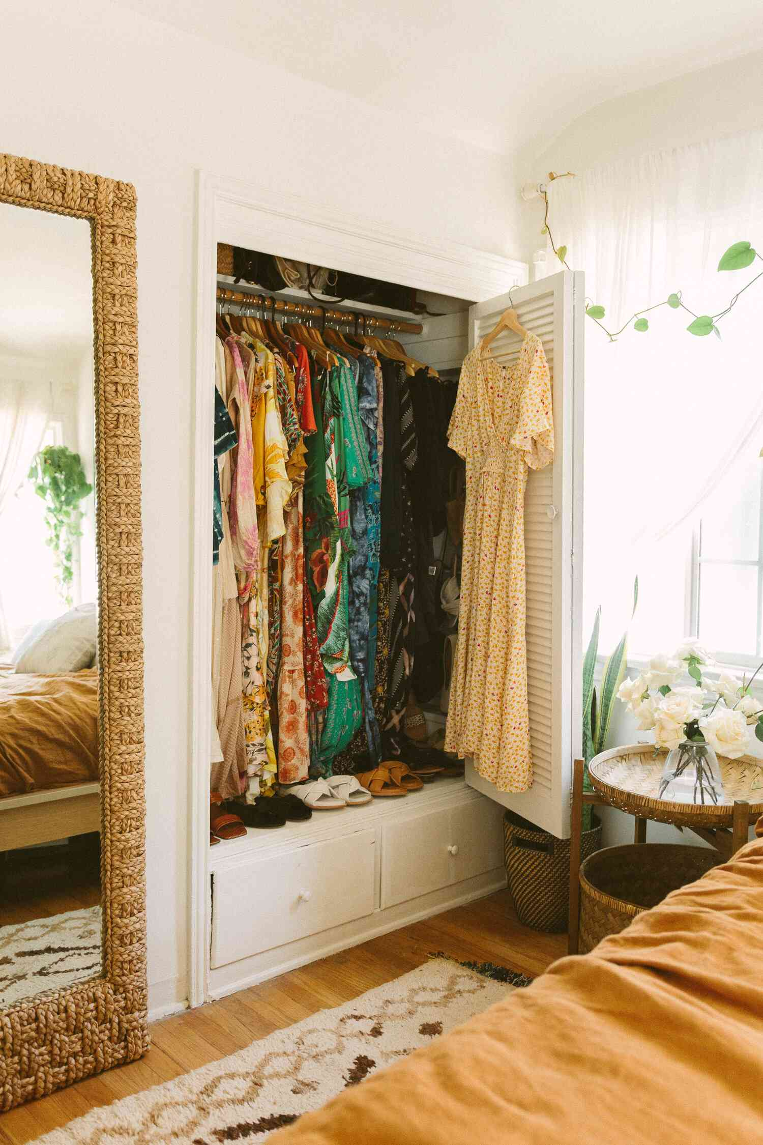 Colorful closet in a bright, sunny bedroom