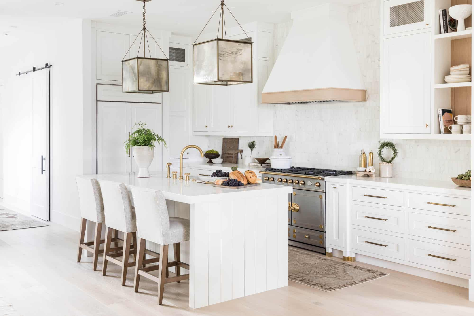 All white kitchen with neutral and organic accents