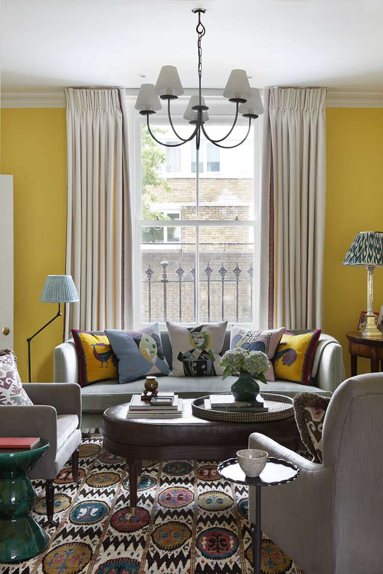 Bright yellow living room with lots of color and pattern