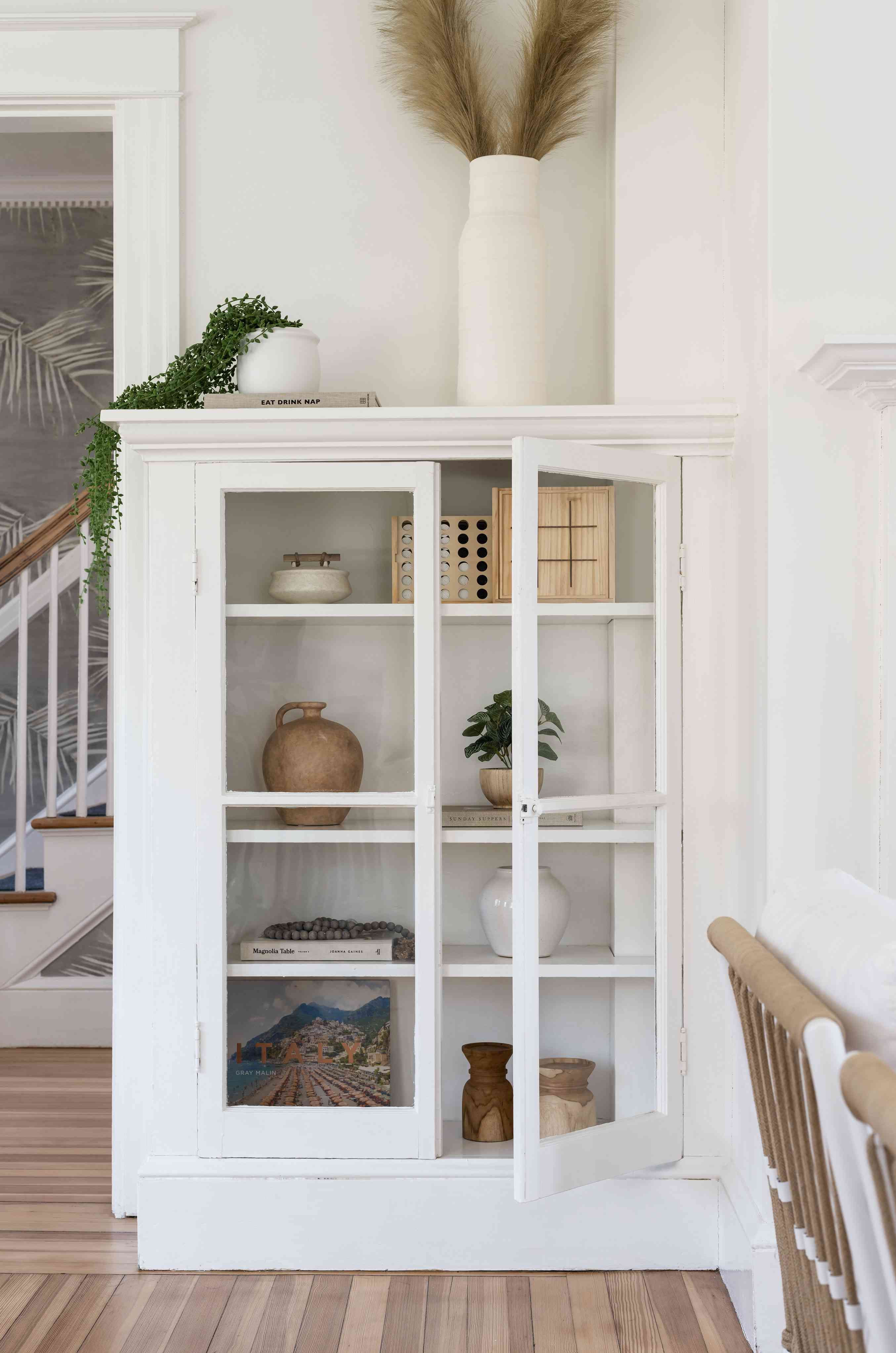 newport beach house living room cabinet with glass doors