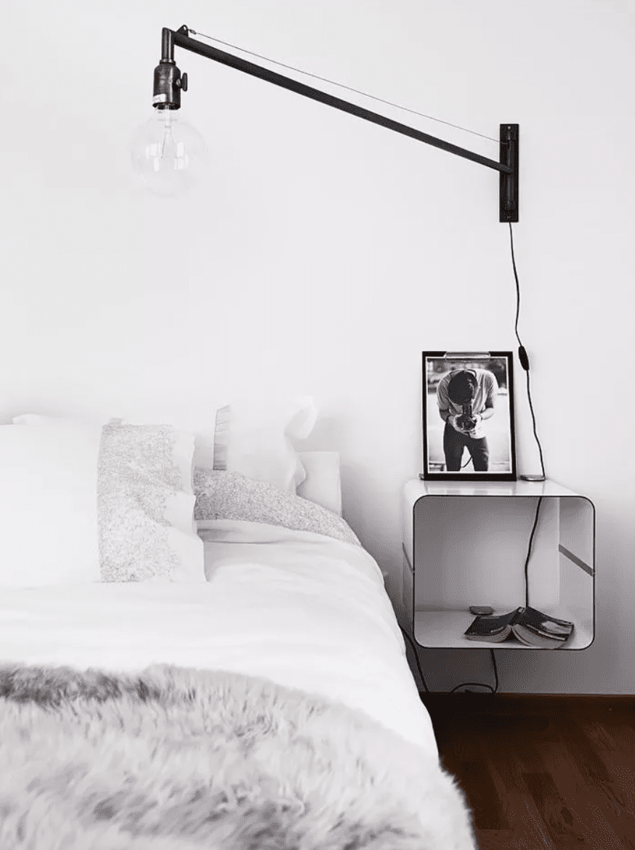 Bedroom with mounted nightstand