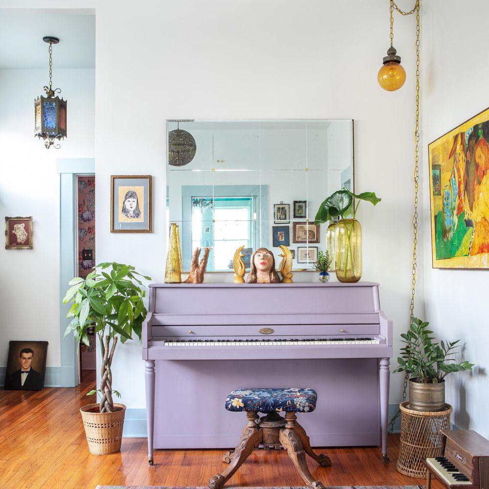 Light purple upright piano in a bohemian sitting area