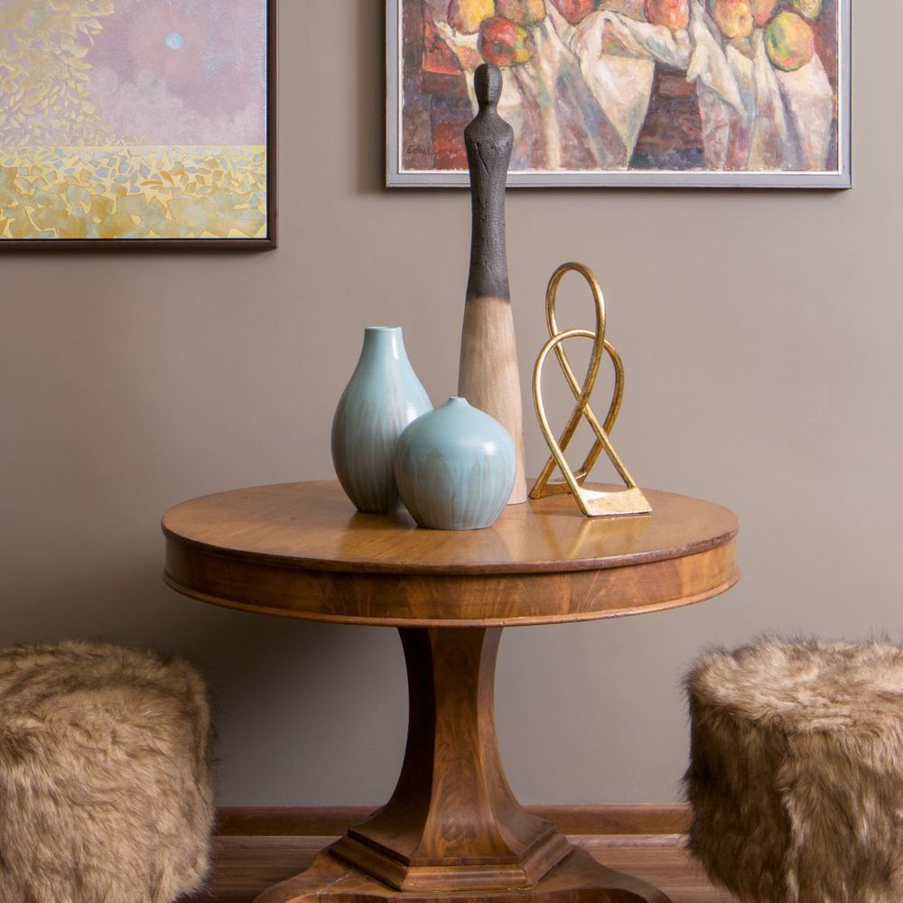 Round table with two textured ottomans