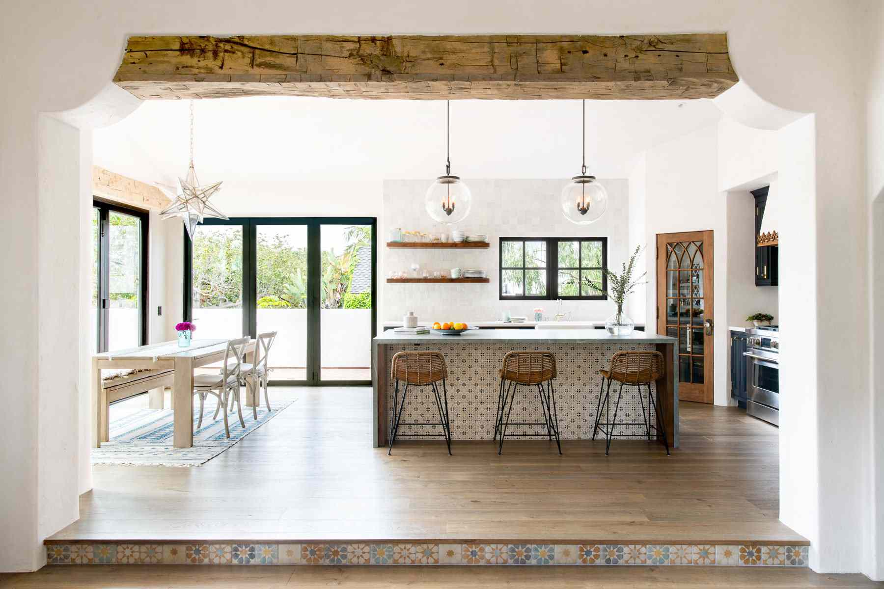 An open-concept kitchen with wood and tile accents