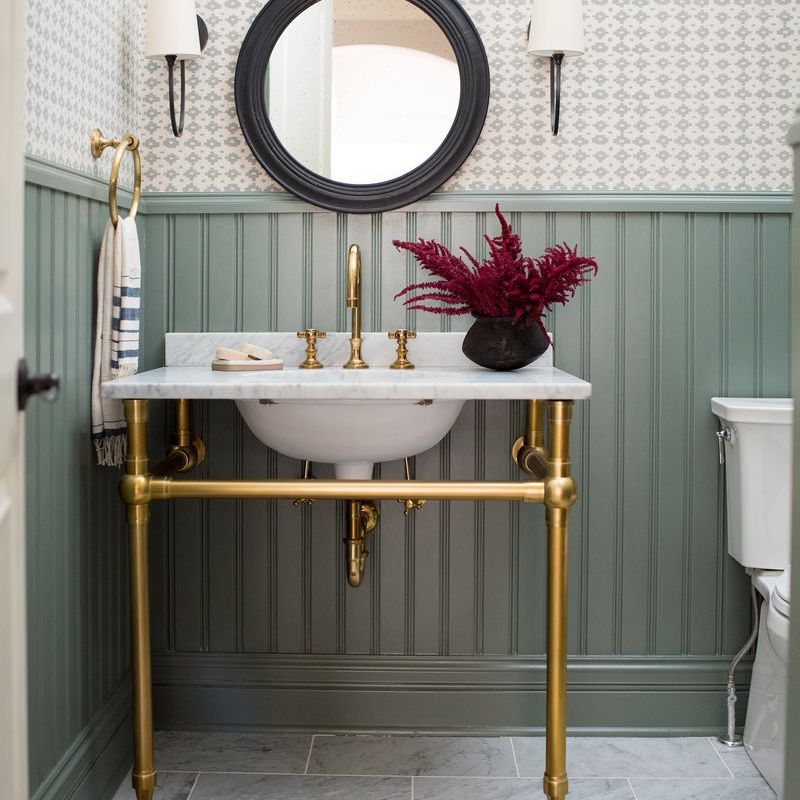 traditional powder room with wallpaper