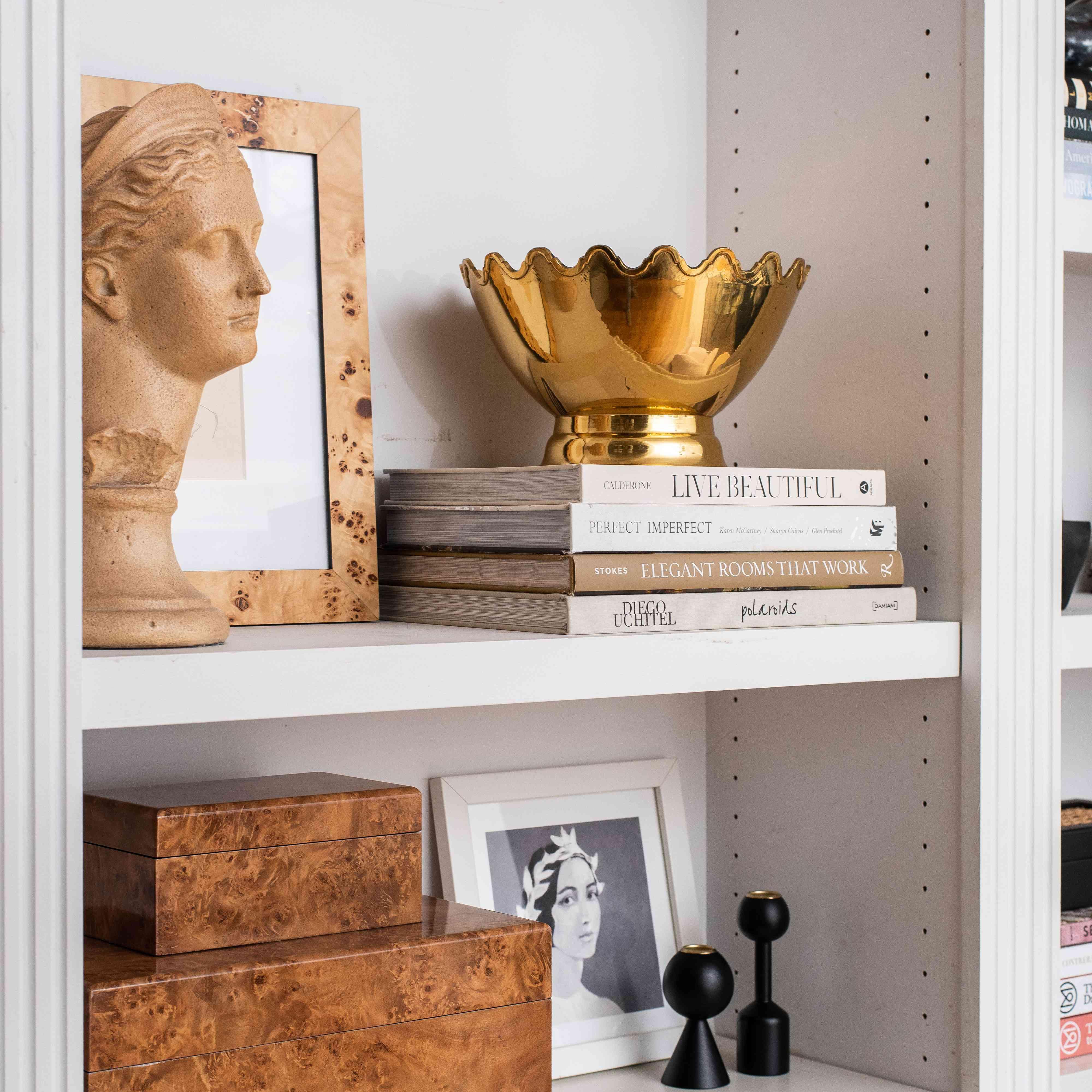 Bust on a bookshelf.