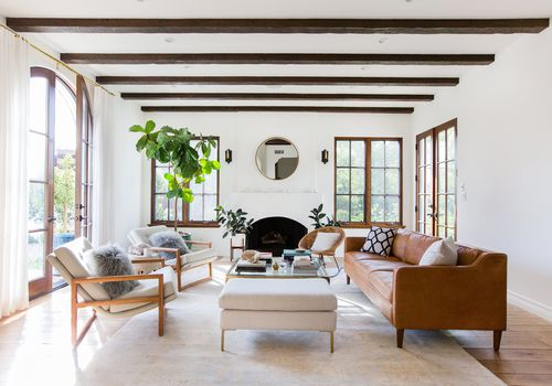 light, bright living room with visible ceiling beams