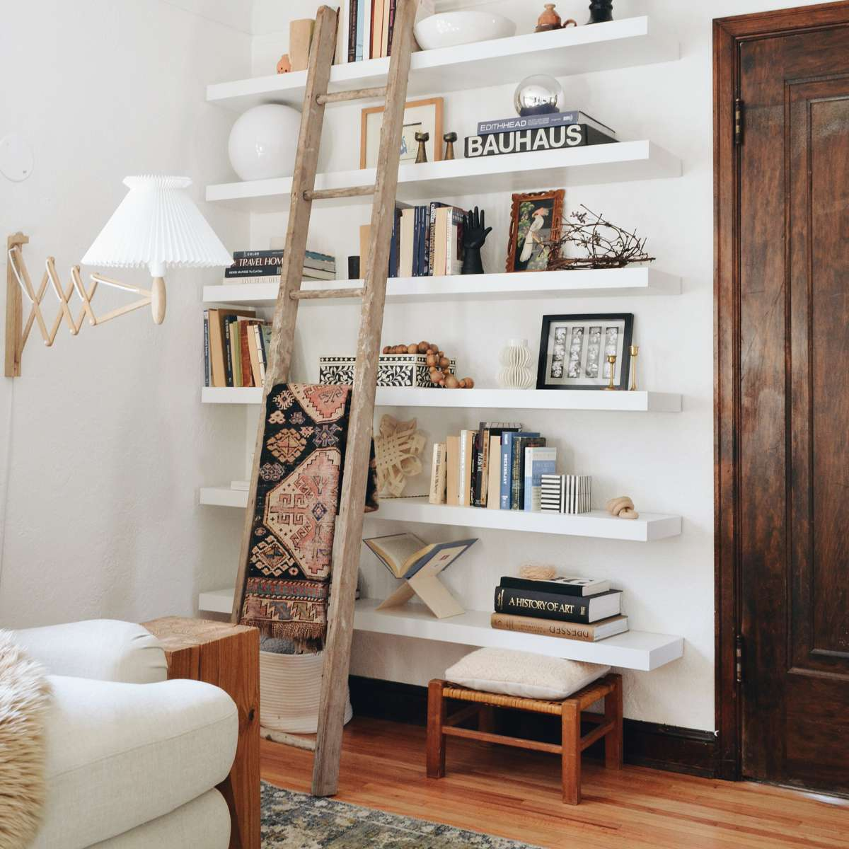 Home library wall with leaning ladder.